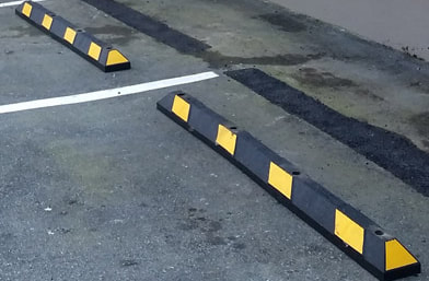 Rubber Wheel Stops Installed in Parking Lot